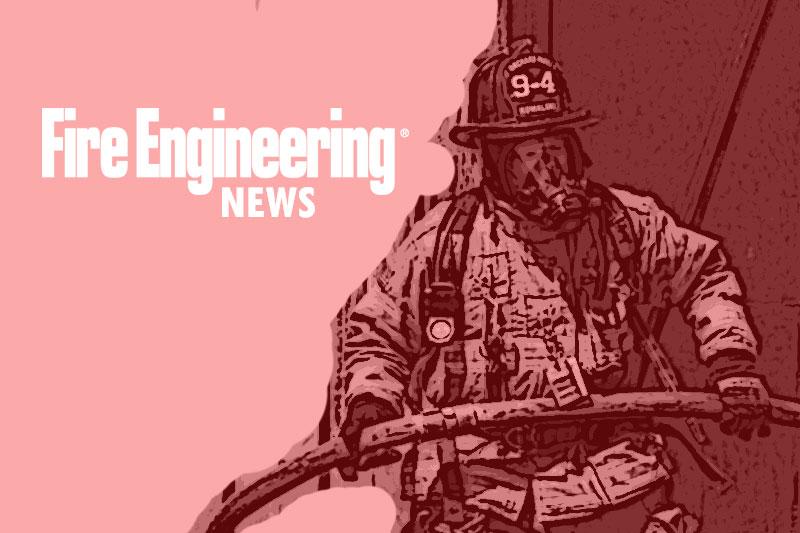 Firefighter advancing a hoseline